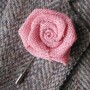 Rolled pink rose lapel flower on sports coat