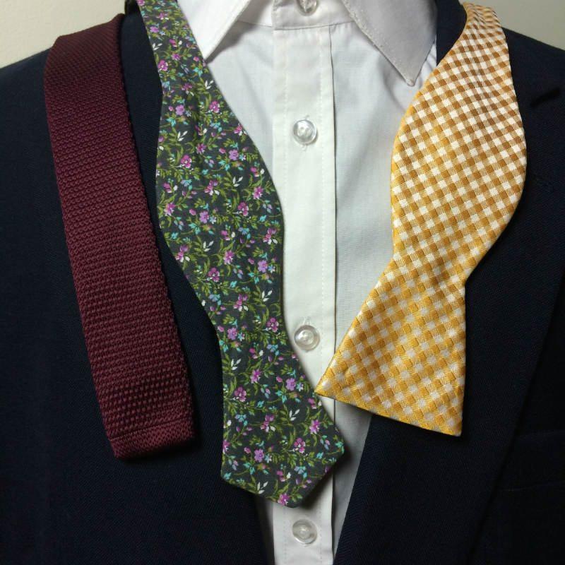 Man with three bow ties
