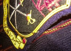 sewing blazer badge on breast pocket