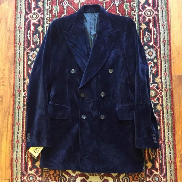 Blue velvet blazer on carpet