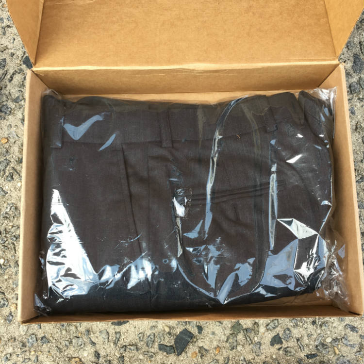 Suit folded in shipping box