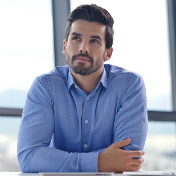 Man-In-Blue-Button-Down-At-Work