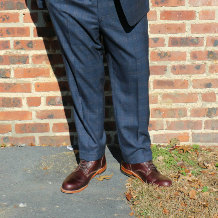 man in suit wearing wolverine boots